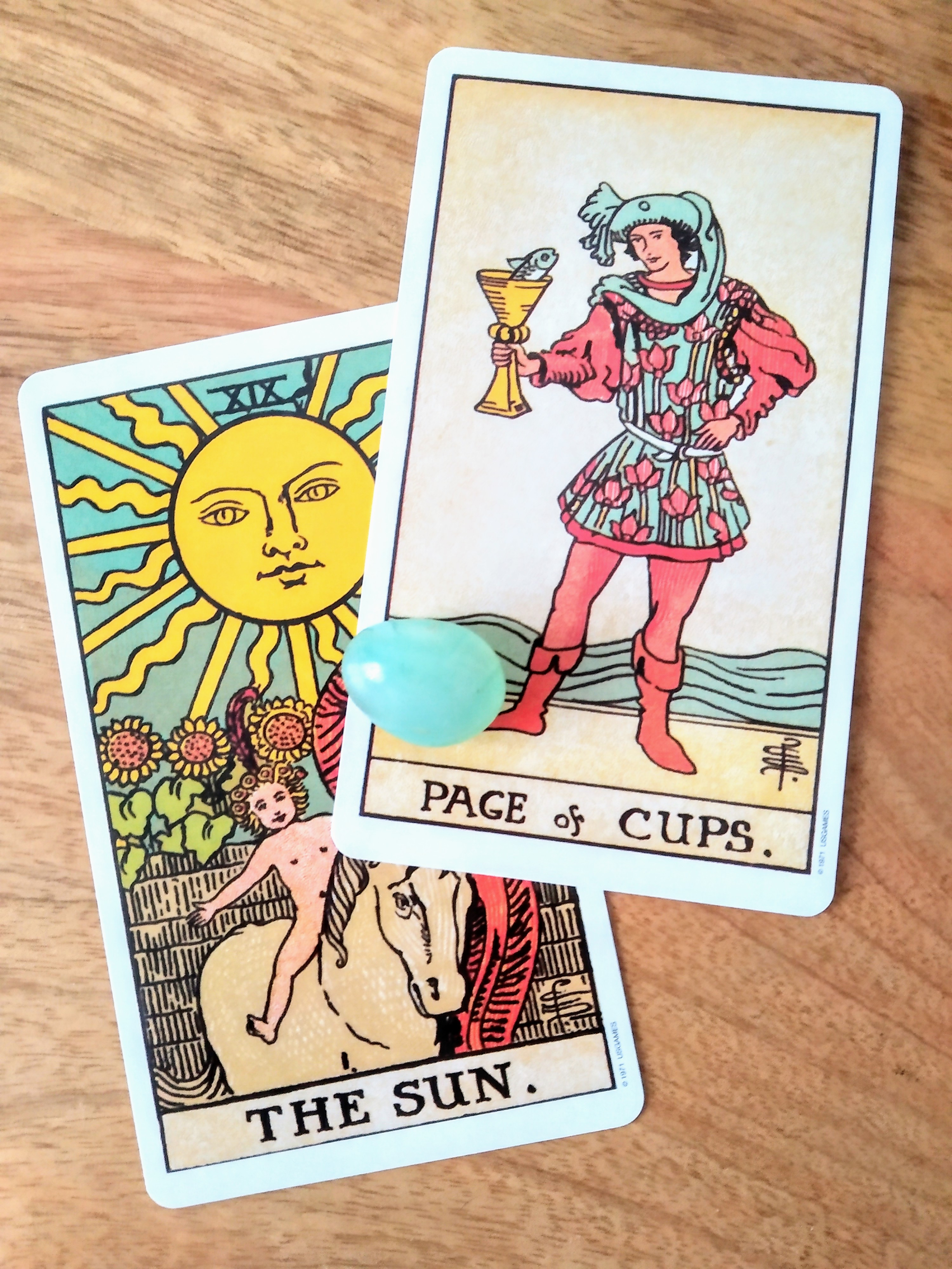 page of cups, the sun tarot